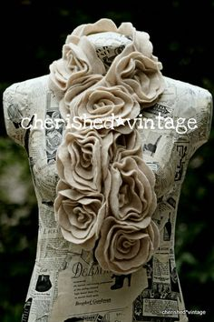 Use this tute:  http://watchmedaddy.blogspot.com/2011/12/felt-flower-scarf-tutorial.html    Use thrifted sweaters...or keep an eye out for awesome sales on garments or fabric.      #thrift