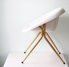 john would hate it, but I could design a room around this chair