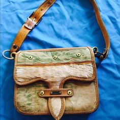 B&B hand bag authentic leather   Boots N Bags by Diva marroquinera  authentic cow leather some scratches and marks overall this is a really unique piece not a big fan of small bags dimension are 8 x 10 handle is 29 inches it weights like a pound  B&B Bags