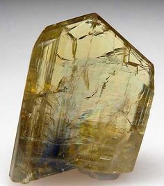 AF973 - Tanzanite $ 950 Merelani Hills, Lelatema Mtns., Arusha Region, Tanzania thumbnail - 2.3 x 1.5 x 0.7 cm - Top quality yellow Tanzanite crystal with just a touch of blue at the base. Complete and undamaged, very nice crystal with good transparency.