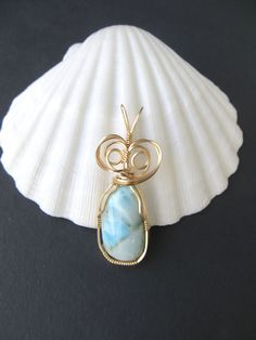 Ocean blue Larimar gemstone pendant in gold filled wire by LindysLane on Etsy