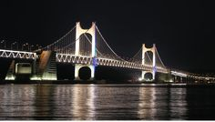 The Gwangan Bridge is a suspension bridge located in Busan, South Korea. It connects Haeundae-gu to Suyeong-gu. The road surface is about 6,500 meters long, with the bridge as a whole spanning 7,420 meters. It is the second longest bridge in the country after the Incheon Bridge. The bridge opened temporarily in September and October 2002 for the 2002 Asian Games. However, it was not officially opened until January, 2003.
