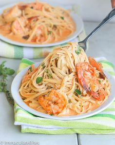 Creamy, Cheesy, Spicy, and fettuccine shrimp scampi bacon –need I say more?  Pure Fettuccine comfort food – and you don't have to leave home…