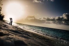 Bride and Groom in a Turks and Caicos sunset beach wedding. Destination wedding photography by Stark Photography. www.starkphotography.com
