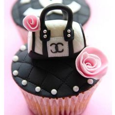 Black cupcakes with a cute little purse and roses! So creative! Love it.