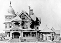 1897-Victorian Home, Los Angeles  Exterior front view of the Victorian style home and carriage house of Aaron M. Ozmun at 3131 South Figueroa Street, Los Angeles, circa 1897. Bradbeer & Ferris were the architects.