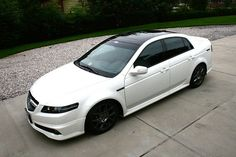 Acura Tls white with black tints and sunroof