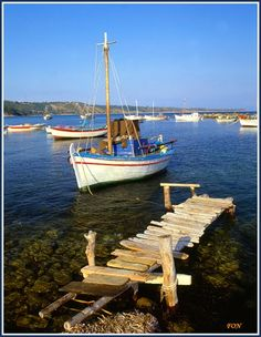 OLD HARBOUR Photo from Kato Katelios in Kefalonia | Greece.com (The boat pictured here belonged to lifelong Katelios resident Dionisios Anninos father of Makis Anninos and grandfather of Eva, Aristo and Dionisios Anninos of Katelios. He also had constructed the wooden platform pictured.