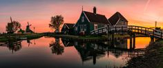 Windmills panorama - A panoramic sunrise shot of the famous windmills of Zaanse Schans in Holland.
