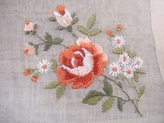 looks machine embroidered, but nice design of rose, buds, and daisies