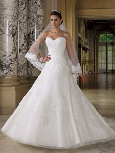 """Number 4 pick- This is so similar to an Alfred Angelo one I tried on and loved......but I think I like the details on this one more. I love the ruched bodice and the sparkle on top of the lace. This is what I imagined wearing for our """"day""""."""