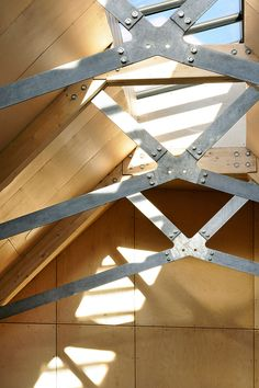 Boatbuilding workshop updated with a contemporary wooden roof.