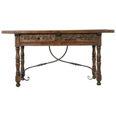 Spanish Renaissance Style Console of Hand-Carved Ash with Iron Stretcher | From a unique collection of antique and modern console tables at https://www.1stdibs.com/furniture/tables/console-tables/