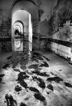 In an abandoned prison.....  http://worldwidephotowalk.com/walk/bucuresti-bucuresti-romania/