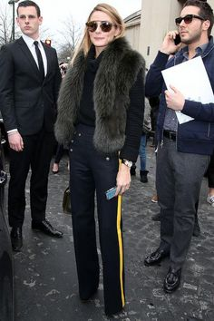 To watch the Elie Saab spring 2016 couture show Olivia Palermo picked sailor trousers with a bold yellow racing stripe and a furry vest. Click for more of her best outfits from the week!