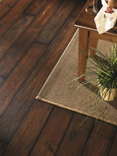 "For basements that double as rec rooms, he suggests wood-look porcelain tile. ""It gives you that relaxed bar look,"" he says, but with the durability and moisture resistance of ceramic. Wait up to a year before installing basement tile to give the house a chance to fully settle. Photo courtesy of Photo courtesy of Mannington"