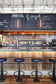 wood, plus dark countertop, chalk board, black industrial metal accents, plus under bar lighting