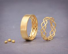 ✿ DESCRIPTION Handmade solid 14k gold rings set. Wedding ring is the one piece of jewelry you wear the most. Hence, its design should go along with everything you wear, from a cocktails dress to your casual outfit. This wedding rings set design symbolizing the bond between a man and a woman and how they complete each other. The WOMANs ring is made from delicate gold wire with a polished finish and the MANs ring is made from a flat gold sheet with matte finish. This set was designed as if ...