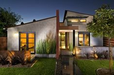 Architecture.  High gloss concrete walkway?  Street View of the home. 8x8x16 Sandblasted Concrete Block, Smooth Stucco, Corten Steel Corrugated Roof. This home won the Concrete Masonry Award Competition.