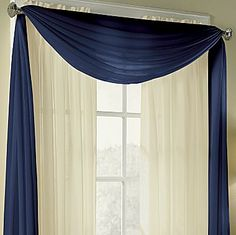 American Living Valances, Cape Sheer Scarf - jcpenney - in light blue to match the pillows on the couch.    Note: this would be really easy (and possibly cheaper, with coupons and sales) to make.