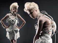 futuristic women's fashion cocktail dispensing dress by Anouk Wipprecht