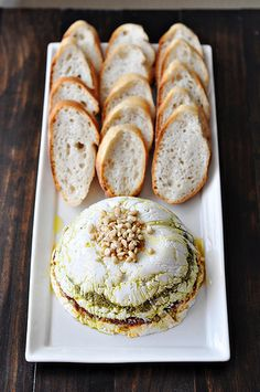 Goat Cheese, Pesto and Sun-Dried Tomato Terrine. #food #dips #appetizers #party #snacks
