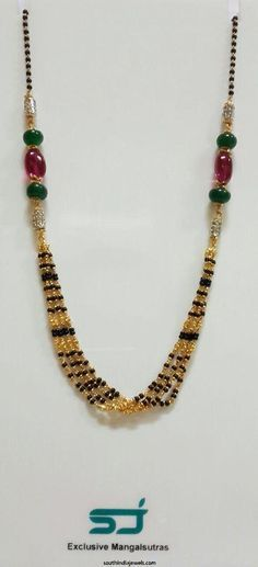 Gold black bead mangalsutra design studded with stones and stringed with precious rubies and emeralds. Gold Bangles Design, Gold Earrings Designs, Gold Jewellery Design, Beaded Jewelry, Beaded Necklace, Gold Necklace, Boho Jewelry, Mens Gold Bracelets, Gold Mangalsutra Designs