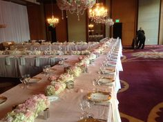 the tables will be lined with flowers in the wedding hues to look similar to this set-up by Flowers Forever Design