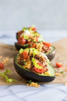 The perfect low carb taco! These avocados are loaded up with the BEST taco meat, cheese, tomatoes, lettuce and a dollop of sour cream. Perfect for an easy lunch or light dinner. Not only can you enjoy the taco toppings, but you get to enjoy the avocado and can even scoop some out for a little guacamole!