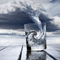 this is a really cool illustration. I love the way the sky is being morphed into the glass of water and really has a turbulent look, as well as maintaining realism. This turned out really nice