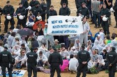 ( Marius Becker/dpa via AP). Demonstrators stage a protest at the open-pit coal mine near Garzweiler, western Germany Saturday Aug. 15, 2015. Banner reads: We do not have to stop protests. leave the coal underground. Several hundred environmental activ...