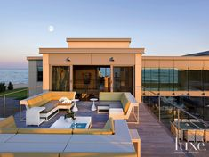 This modern home designed by Patterson Disston Architects and constructed by Enterprises, Inc. is the ultimate summer get-away with multi-level decks, a swimming pool, an outdoor kitchen and tennis and basketball courts.