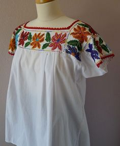 Mexican embroidered beaded blouse huipil - Puebla - traditional vintage China Poblana - Boho Frida style - MED/Large. by LivingTextiles on Etsy https://www.etsy.com/listing/197827604/mexican-embroidered-beaded-blouse-huipil