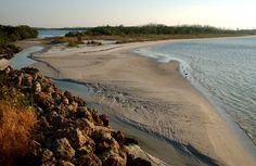 Northern tip of the island is bordered by the estuary and Big Carlos Pass. Lovers Key State Park, Florida.
