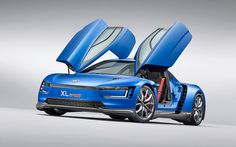 Volkswagen has unveiled at 2014 Paris Motor Show the XL Sport, a concept car that features an high-tech Ducati V-Twin engine. Auto Volkswagen, Volkswagen New Beetle, Pick Up, Diesel Hybrid, Fiat 500x, New Ducati, Touareg, Ducati Motorcycles, Motorcycle Engine