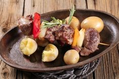 Venison Kabobs Recipe with a sprig of rosemary for garnish, served with a side of potatoes.This delicious, easy-to-grill venison kabob recipe will make your mou Grilled Venison Recipe, Venison Goulash Recipe, Easy Venison Recipes, Best Venison Recipe, Beef Kabob Recipes, Venison Meat, Grilling Recipes, Cooking Recipes, Game Recipes