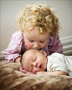 Big sister and baby - love those curls