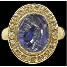 "Signet ring:  (gold with sapphire intaglio [made in Alexandria in the 1st century BC], Europe [possibly England], c. 1275-1300), the intaglio carved with the head of a veiled lady, the oval bezel inscribed in Lombardic letters ""* TECTA: LEGE: LECTA; TEGE."""