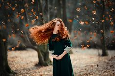 "Lily-"" Her fire red hair blew in the wind gracefully as she stood in the forest. The Autumn leaves fell softly and slowly from the trees to the ground all around her, it was the picture of change..."""
