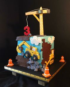 Construction backhoe cake. The Flour Basket Cake Shop