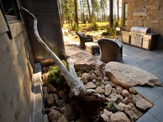 Similar to our outdoor front stone & driftwood area! - Outdoor Kitchen Pictures From HGTV Dream Home 2014 on HGTV