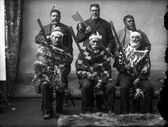 Portrait of six unidentified Maori men, with weapons - Photograph taken by William Henry Thomas Partington