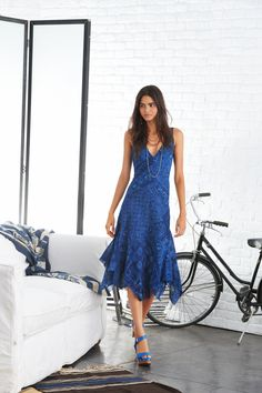 Featuring an artful patchwork pattern and a sexy V-neckline, this Polo Ralph Lauren breezy cotton gauze dress is designed with a swingy layered skirt and a handkerchief hem.