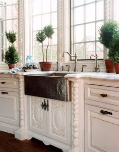 hammered farmhouse sink, would love to have this as my kitchen sink and dig those windows, Always had a big kitchen window to look out of growing up, would love to have it again. :0)