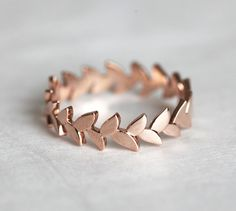 Another ring with a beautiful design, this leafy wedding band by capucinne is perfect for the nature-loving bride.
