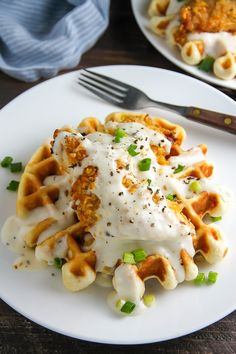 "Fluffy buttermilk waffles topped with crispy ""oven-fried"" chicken and creamy white pepper gravy. Brunch perfection."