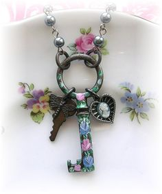Antique Circle Skeleton Key Necklace Enamel Roses Cameo Dragonfly ~by The Vintage Heart on Etsy ~ I have bought from this seller - you will NOT be sorry! This stuff ROCKS!!! :)