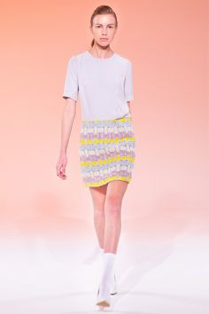 Calla Fall 2013 Ready to Wear: The 60's Miniskirt with bright colors and a wild pattern on it, she has on white  gogo boots