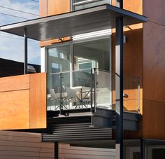 #colizzabruni #modern #hintonburg #infill #marinemahogany #plywood #metalsiding #home #design #minimalist #ottawa #exterior A fully glazed south wall opens onto a large cantilevered terrace providing an interstitial space between the private realm of the house and the public realm of the street.