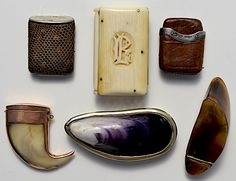 Victorian artisans were enthralled with the natural world, so it was little wonder that natural materials such as (clockwise from top left) snakeskin, ivory, leather, horn, shell, and tooth were used to construct match holders.